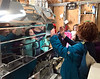 HOLLY PELCZYNSKI - BENNINGTON BANNER Village School of North Bennington second graders Chloe Myran, Addie Newbold and Chase Mears makes faces and strike poses while seeing their reflection in a sap boiler on Monday during a visit to to a local neighborhood sugaring farm on Monday in North Bennington.