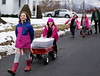 HOLLY PELCZYNSKI - BENNINGTON BANNER Village School of North Bennington Second graders Nieve McKenna and Mirabella Breithaupt pull a wagon filled with maple sap down the road to a sugar shack to get it boiled and bottled into maple syrup, on Monday afternoon in North Bennington.