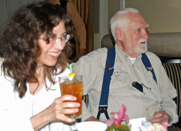Fencing club alumnus Carole Fernandez and Dr. Richard Stearns, faculty advisor, at the Friday evening get-together.