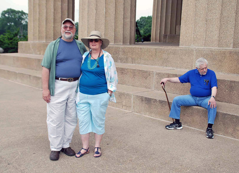 Doug Huggins and his wife, Corie, and Steve Block at the Parthenon.