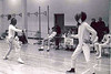 Jess Fleming fencing on left.  Ray Finkleman seated on right.