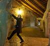 Monique attempts a climb inside the Predjama castle in Postonja Slovenia.