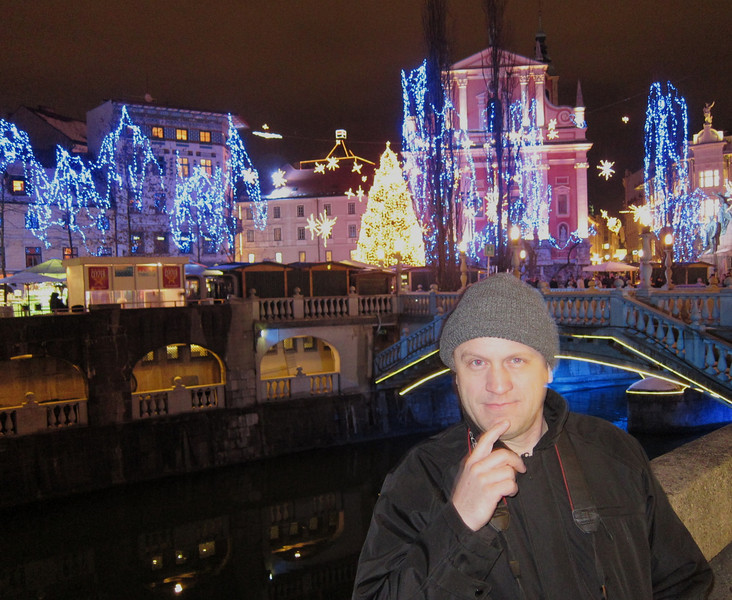 """Ken ponders the meaning of """"Happy December"""" in Ljubljana.  He thinks it might be largely attributed the hot wine that is consumed in large quantities."""