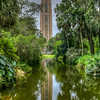 The tower was built at the highest elevation of the site, south of a reflection pool that allows the water to reflect its full image. A 60-bell carillon (cast by Taylor) set within the 205-foot (62 m) tall, Gothic Revival and Art Deco tower that was designed by architect Milton B. Medary. Construction on the tower began in 1927 and was completed for the dedication of the gardens in 1929, when it was dedicated by President Calvin Coolidge. The tower is 51 feet (16 m) square at its base, changing form at 150 feet (46 m) high to an octagon with 37 feet (11 m) sides that include sculptures designed by Lee Lawrie. It is built of pink Etowah marble and gray Creole marble, mined in Tate, Georgia, and coquina stone from Daytona Beach. (Wikipedia)