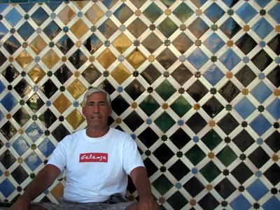 Richard against tile in the Alhambra