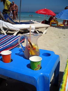 Enjoying champagne sangria on the beach (beach towels from Target - lol)