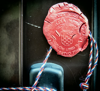 This is what the government uses when someone is locked out of their property for nonpayment - a wax seal and sting.  So much more civilized than a padlock and chains.