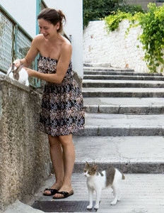 A lady with her pet rabbit and cat