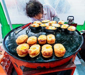 Street Vendor - never tried these, but looks like bread with an egg baked on top.