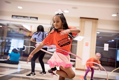 Lourdes Zaya spins her hula hoop around as she plays with her group during Vacation Bible School June 27 at St. Paul the Apostle Parish in Richardson.