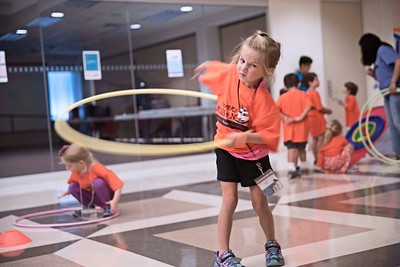 Libby Orr spins her hula hoop around as she plays with her group during Vacation Bible School June 27 at St. Paul the Apostle Parish in Richardson.
