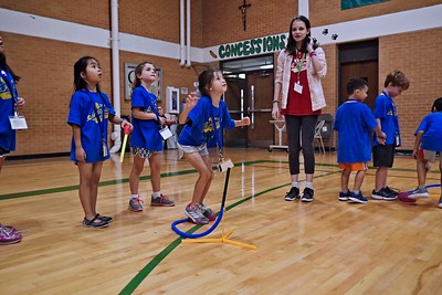 Emily Rebuck launches a foam rocket into the air as friends watch during Vacation Bible School June 15 at St. Patrick Parish in Dallas.