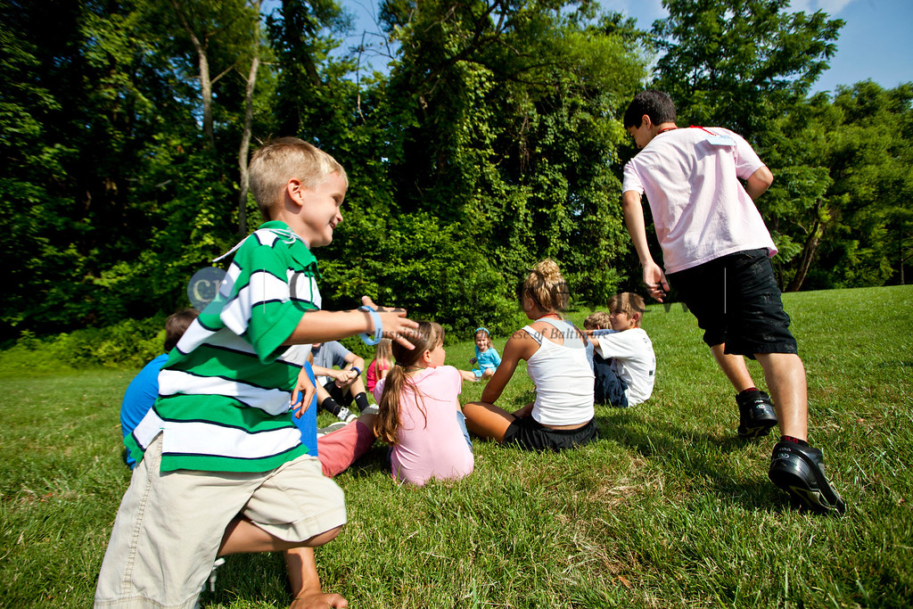 Cameron Herring, 6, chases John Pitser, 14, during a game of duck duck goose at St. Ignatius, Hickory June 28.