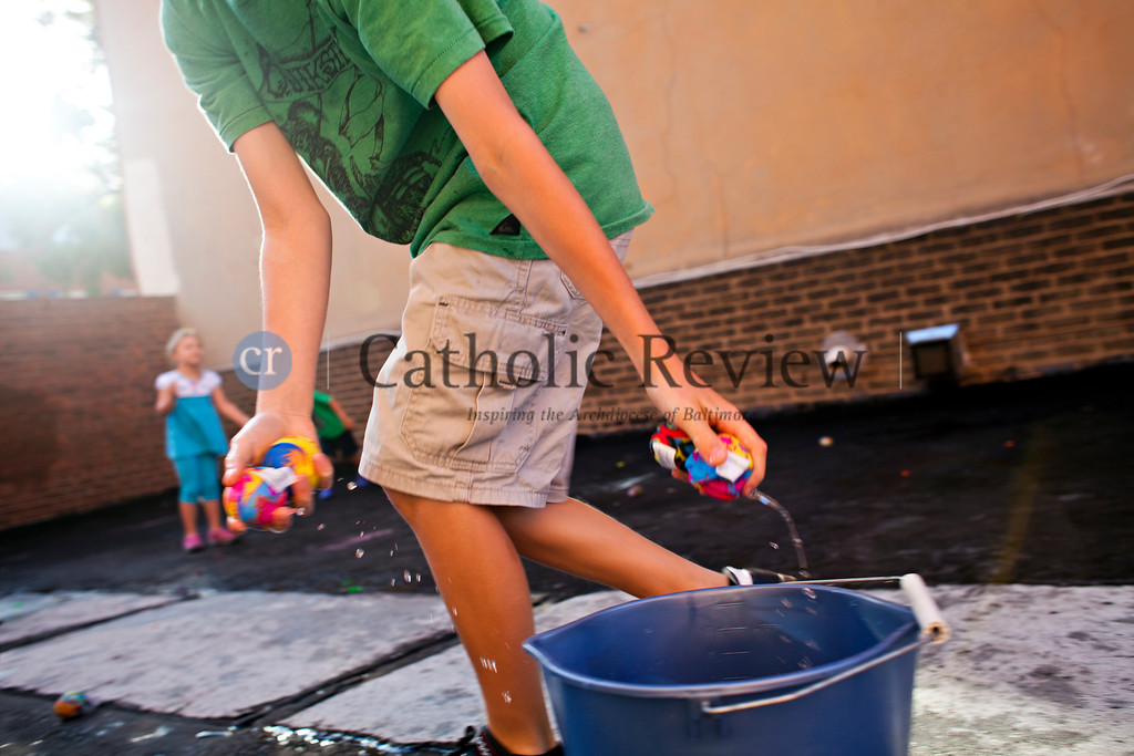 Vacation Bible School students at the Catholic Community of South Baltimore play with water toys and water balloons June 26.