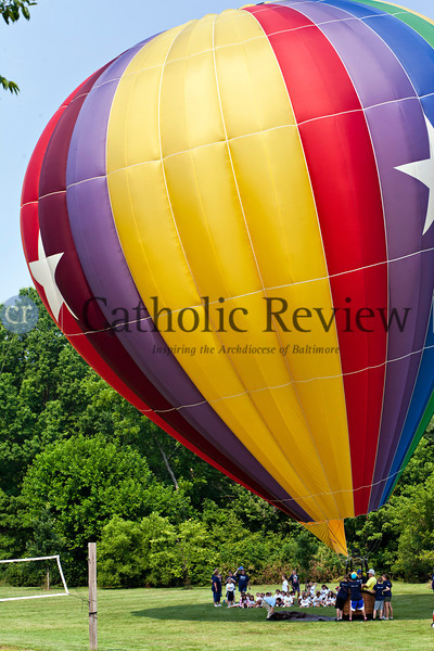 Vacation Bible School students at St. Peter the Apostle in Libertytown are treated to a demonstration of a real hot air balloon June 29.