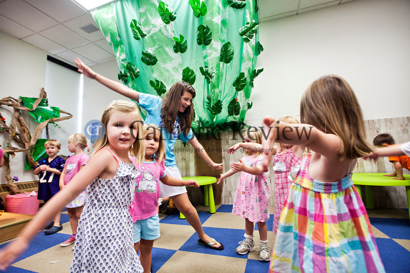 Pre-school campers do a worship dance party before heading to the next station at the Church of the Nativity in Timonium June 28.