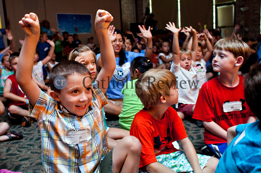 Charlie LaNasa, 6, stretches his arms into the air the Vacation Bible School at the Church of the Nativity in Timonium June 28.