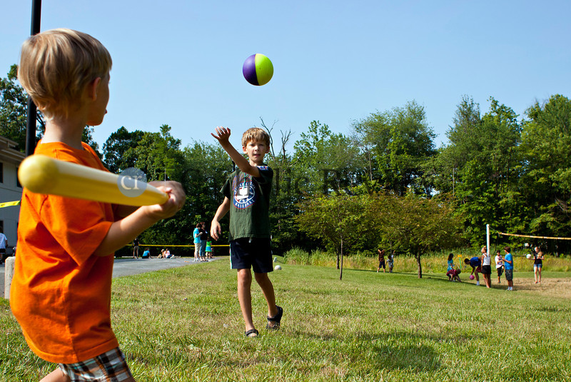 Ryan Dean, 5, prepares to take a swing a pitch from Thomas Coudon, 10, during Vacation Bible School at St. Ignatius, Hickory June 28.