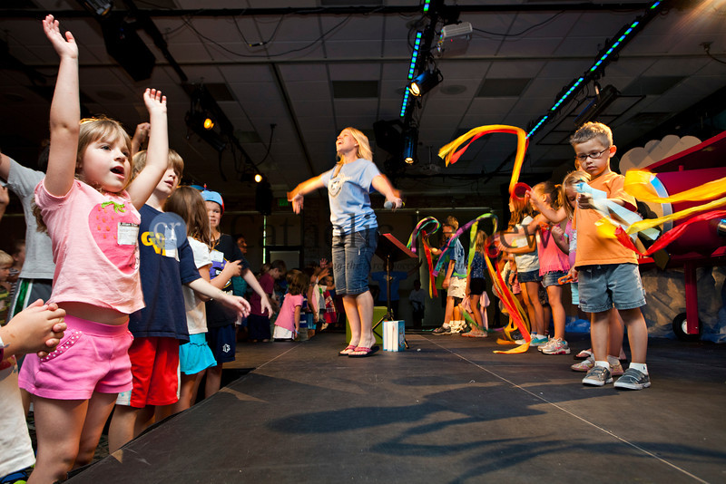 Kristin Costanza leads the Vacation Bible Schoolers in song and dance as the end of the day draws near at the Church of the Nativity in Timonium June 28.