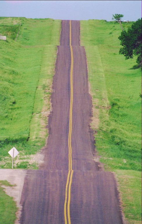 This photo was taken from the geographical center of the United States, a few miles from the small town of Lebanon, Kansas.  This road is the only road leading in and out to the geographic center and marker.