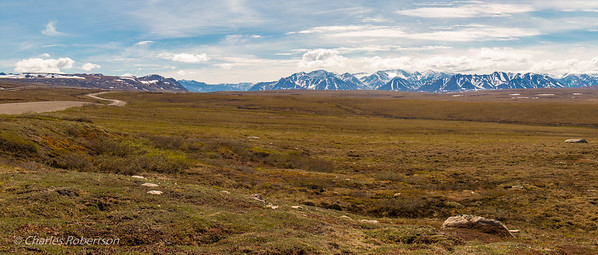 Approaching the Brooks Range along the Dalton Highway (seen on the upper left). Further to the upper left, note the Trans-Alaska Pipeline.