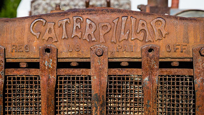 A clsoe-up of the artistic Caterpillar logo on this old tractor, probably from the early 1930's.