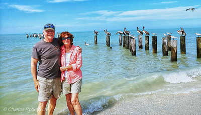 Enjoying the beach in front of old Naples Pier