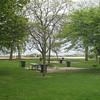 Picnic tables,  lake shore beach.