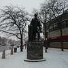 Snow-dusted statue of Abraham Lincoln at Lincoln Square in Chicago.