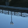 Reflected side rails of the West Lawrence Avenue Bridge.