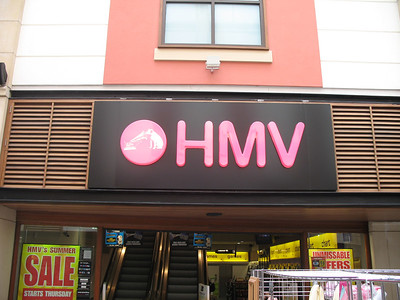 HMV (His Master's Voice, the British version of RCA) is big-time record chain in the UK. I bought a bunch of CDs at HMVs in Guildford, Oxford, and Portsmouth. (Thanks to Will Murray for reminding me what HMV stands for.)