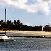 Catamaran and breakwater at Haleiwa Boat Harbor.
