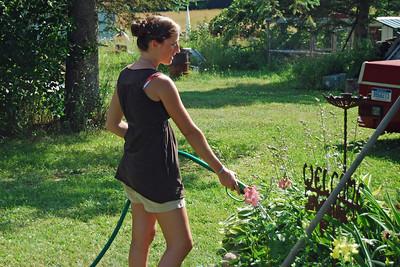 0030 Monique watering the garden