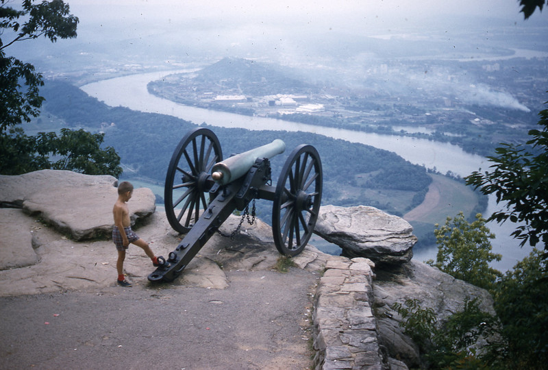 Confederate cannon overlooking the Tennessee River atop Lookout Mountain.  William A. Shaffer is shown standing by the cannon.