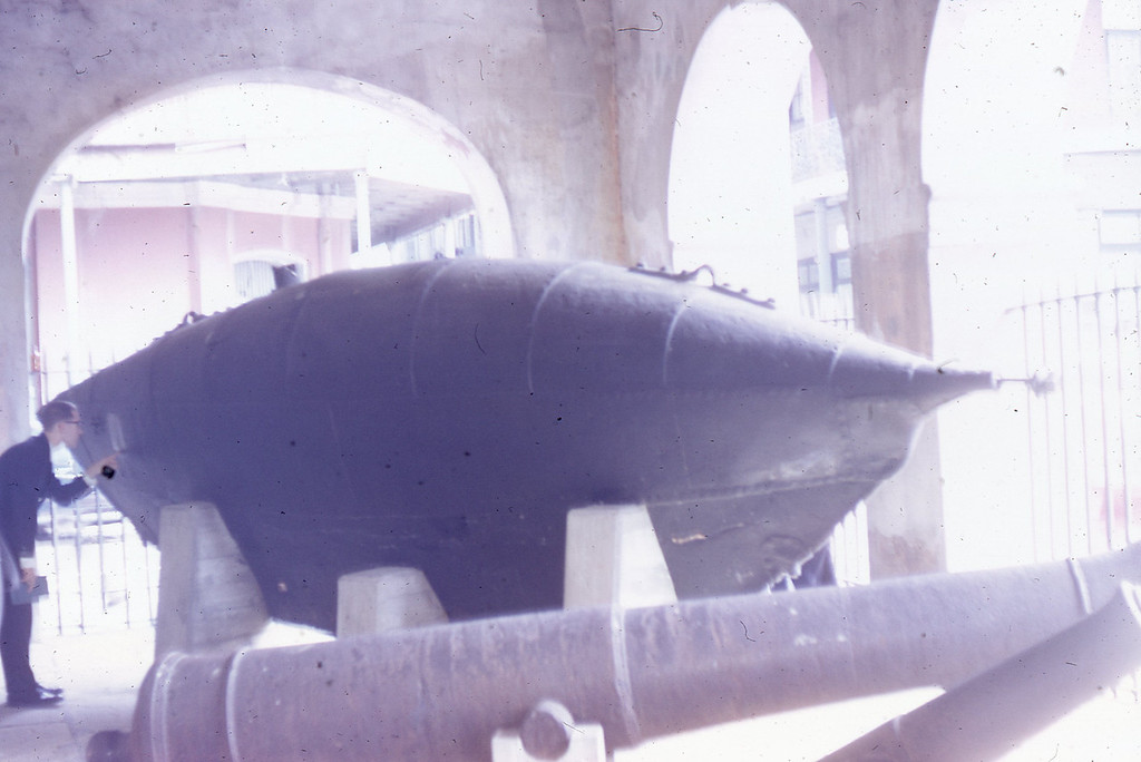 "William A. Shaffer inspecting the Confederate Submarine ""Pioneer"", then located at the Presbytere in the French Quarter."
