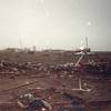 The morning after the F4 tornado hit Saragosa.  Notice the stunned cow, and the flag in foreground.