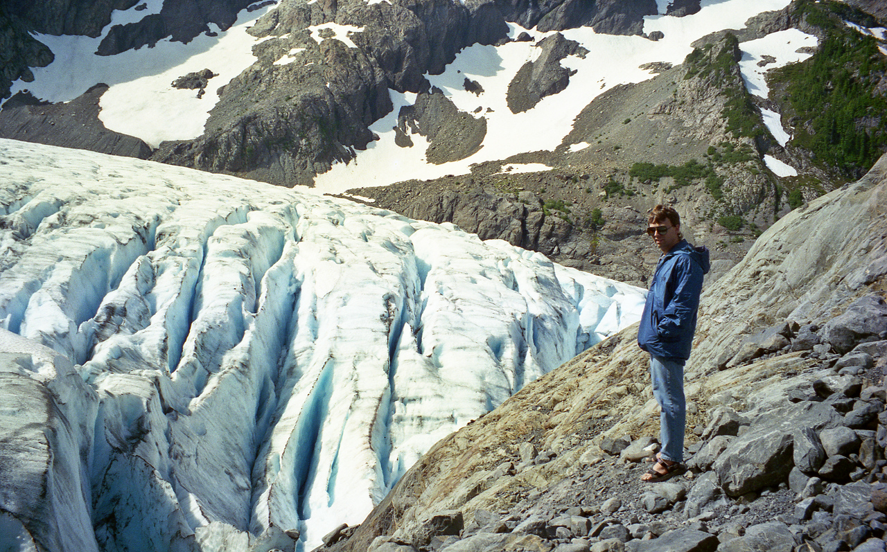 Roger with Blue Glacier down below.  This picture is very deceiving.  It looks like he is just standing next to a pile of snow, but the glacier is actually way off in  the distance