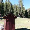 The outhouse at the top of the road.  We each took our turn in it.  Pretty nice inside really, except for all the bullet holes.