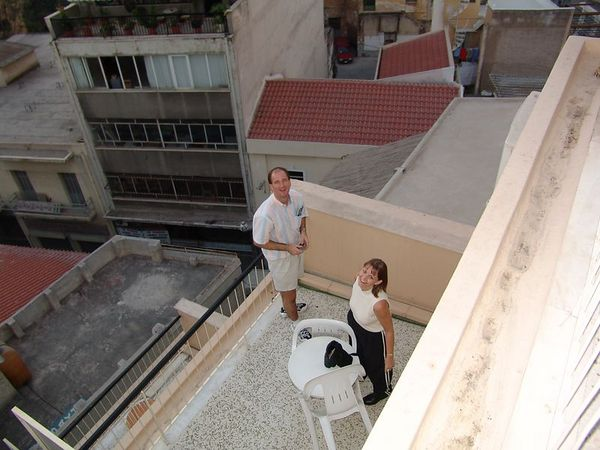 Chris and Bret on the balcony below us in Athens.