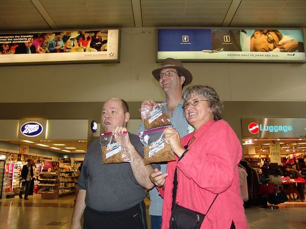 At the Heathrow airport in London.  Lee's cookies at their first destination.  Chuck, Tim and MarySue.
