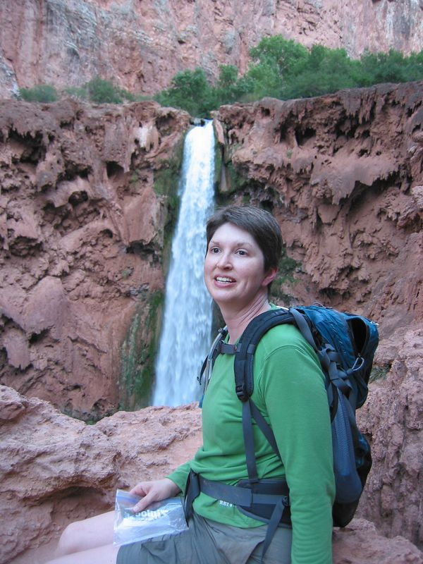 Linda at Mooney Falls.  Mooney falls is just below the campground in Havasu Canyon and is the tallest fall along Havasu Creek.  The trail from the top of the falls to the base is difficult as it requires working your way down/up using hand holds, chains, and drill steel embeded in the rock at places.