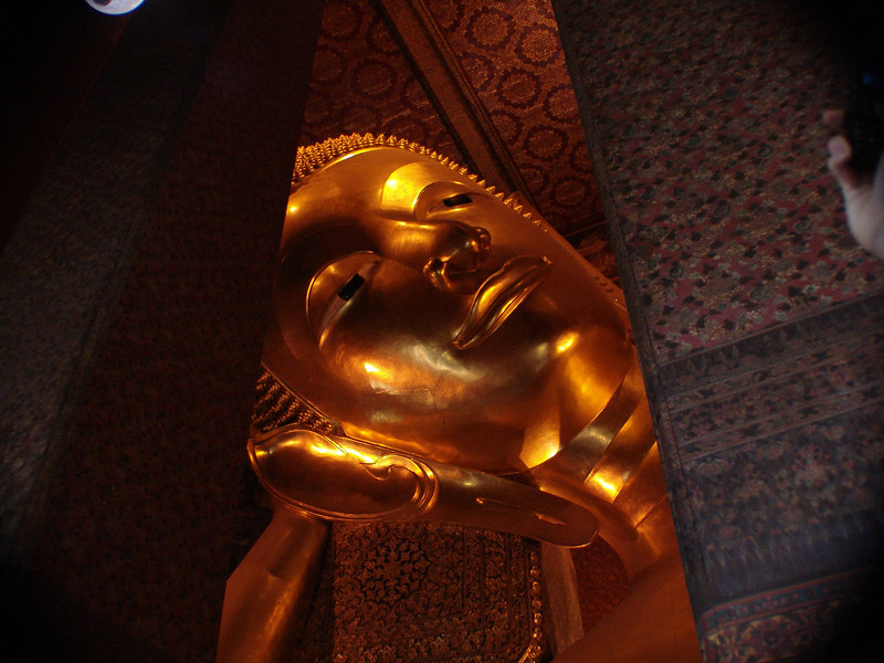 We're now at Wat Po, the home of the Reclining Buddha.  46 meters long and 15 meters high.