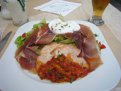 Peggy ordered a Basque version of a chef salad.  It included dried ham as well as lomo and an egg.