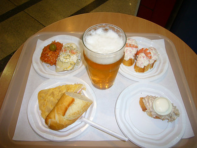 """pintxos (pronounced """"pinchos"""" or tapas).  Nothing fancy.  We were hungry and desparate and it was before lunch.  We found a mall that was open and I ordered some cold tapas.  Many are served with an egg on top.  We had a few of these at a bar in St. Jean-de-Luz."""
