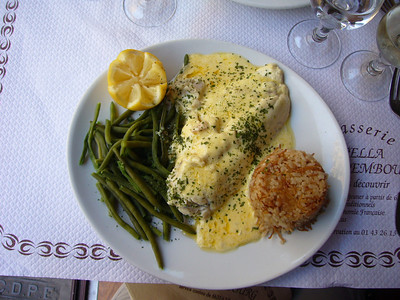 Poisson du jour (I like taking risks).  This was cod with a white sauce with green beans and rice pilaf.  The vegetables in France are amazing.