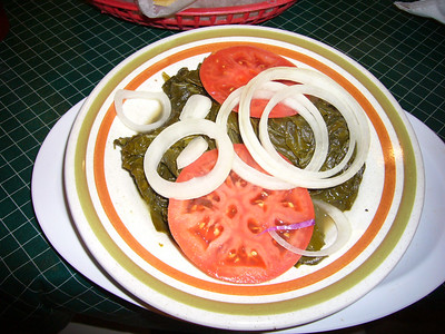 Veggie special of the Little Tea Shop.  Turnip tops, onions and tomatoes.  Great flavor combination!