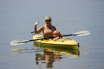 Judi gives Beverly a ride in the kayak