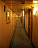 A view down one of the long hallways on either side of the ship.