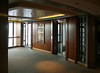 The main elevators in the center of the ship were very unusual. The doors between the elevators and the lobby were glass, as were the walls of the elevator itself and the walls around the elevators. Basically you could see through everything!