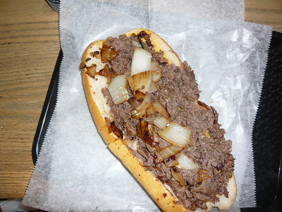 Jim's Steaks on South Street.  My mom's favorite cheese steak.  We ordered one with extra meat and split it.  Try doing that without a knife.  :-)